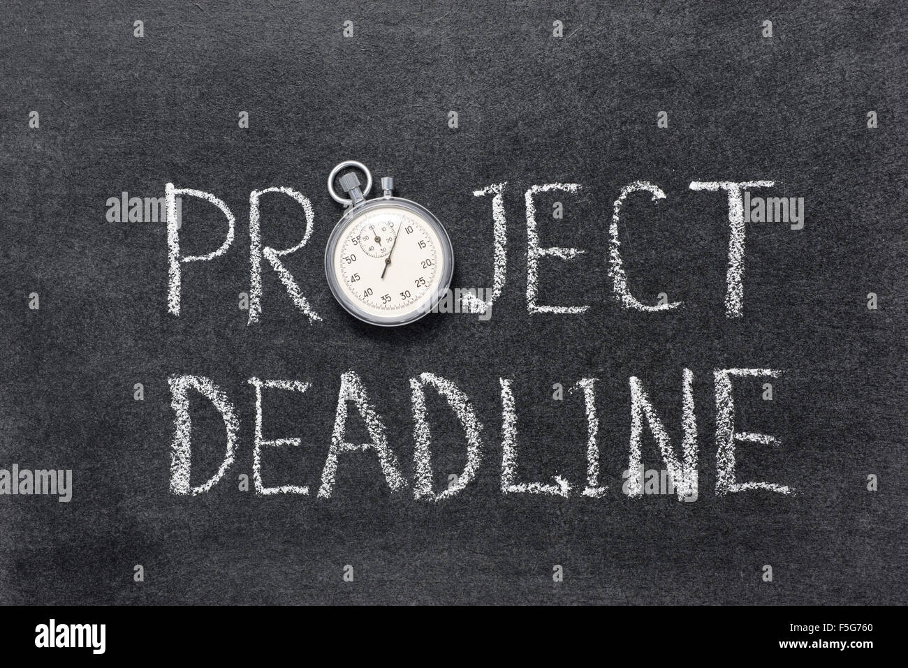 project deadline phrase handwritten on chalkboard with vintage precise stopwatch used instead of O - Stock Image