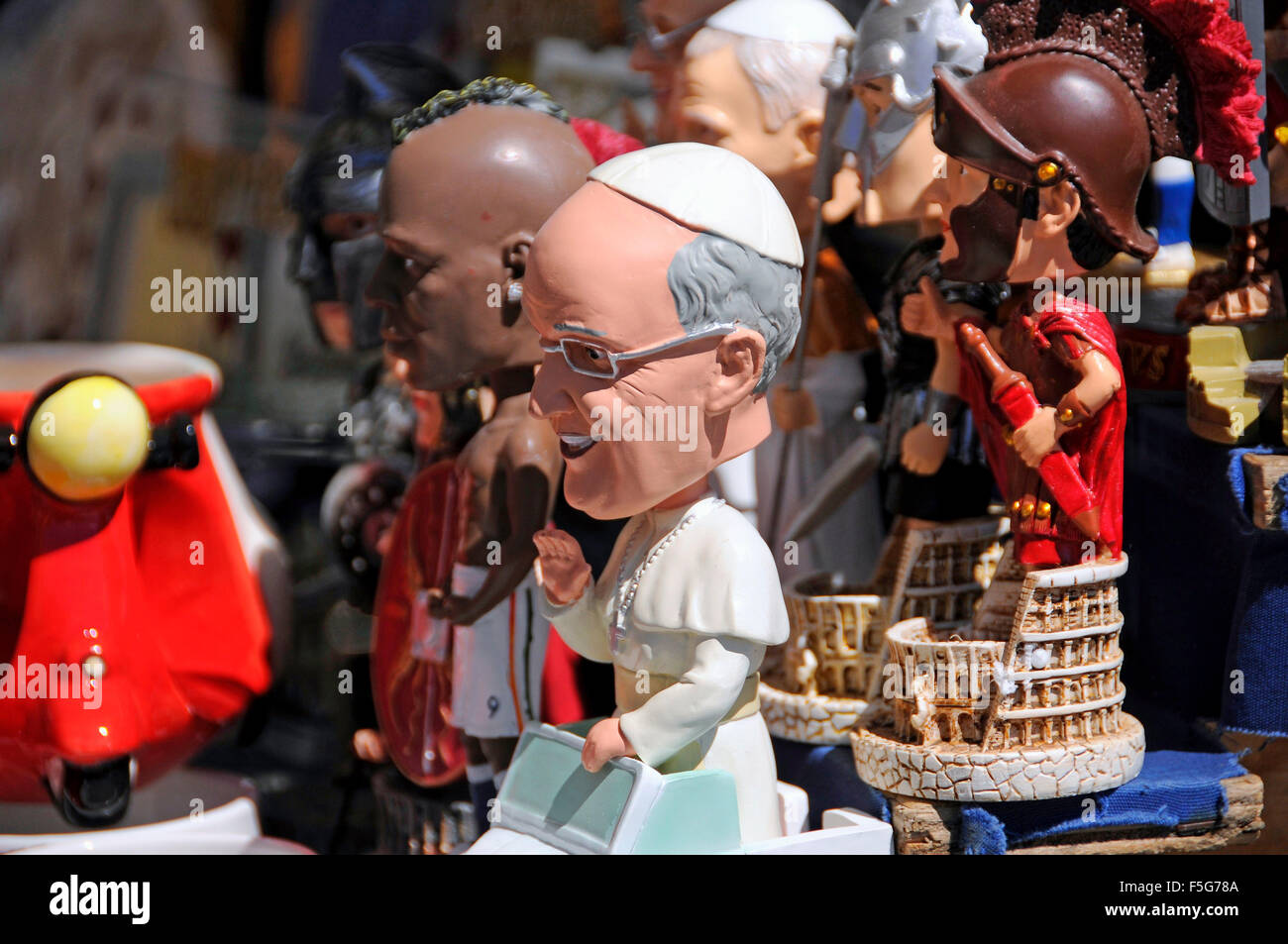 Souvenir stall in Vatican City with figurines of Pope Francis, Gladiators and footballer Balotelli in Rome, Italy - Stock Image