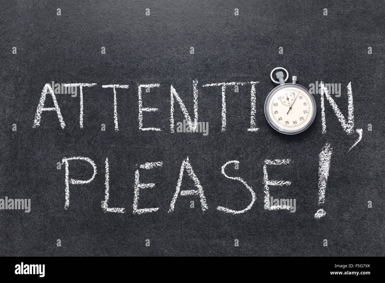 attention, please exclamation handwritten on chalkboard with vintage precise stopwatch used instead of O - Stock Image