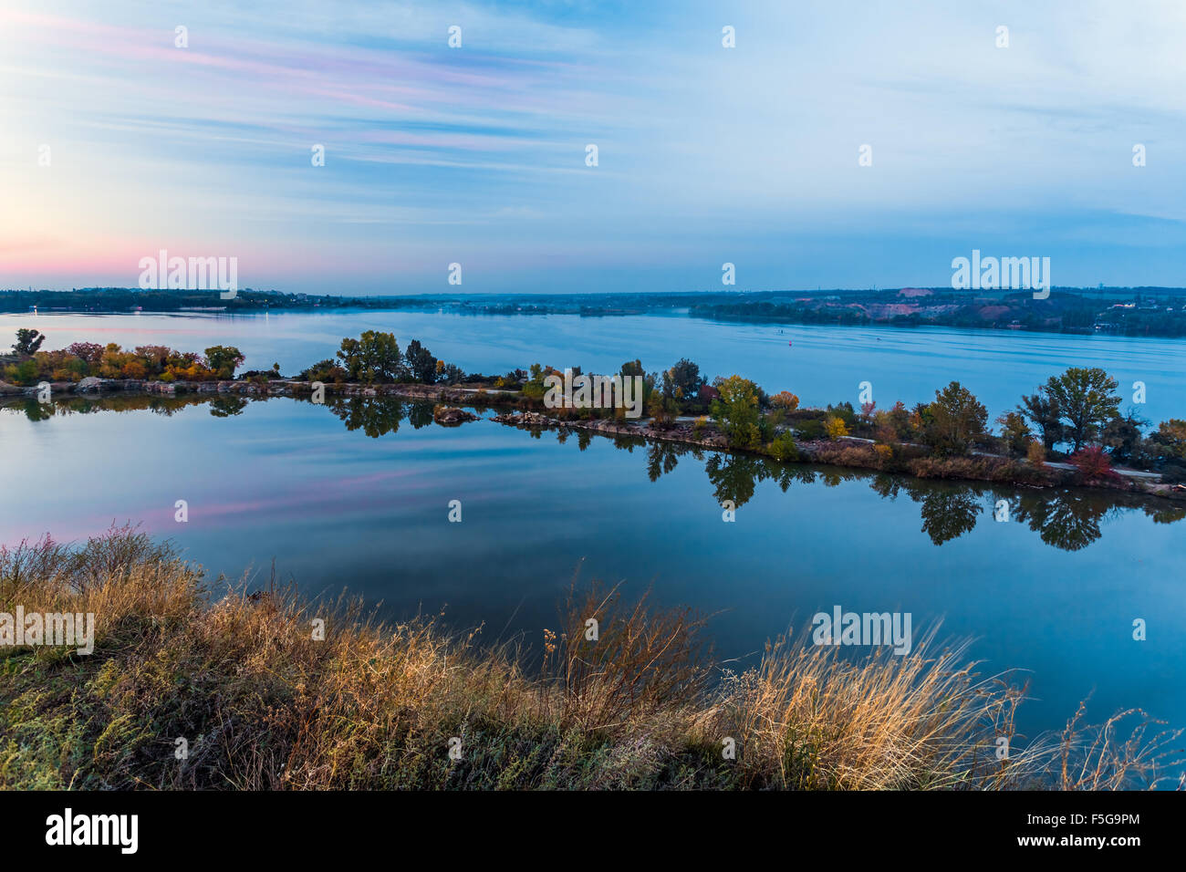 Tenderly colored sunset landscape at East European waterfront - Stock Image