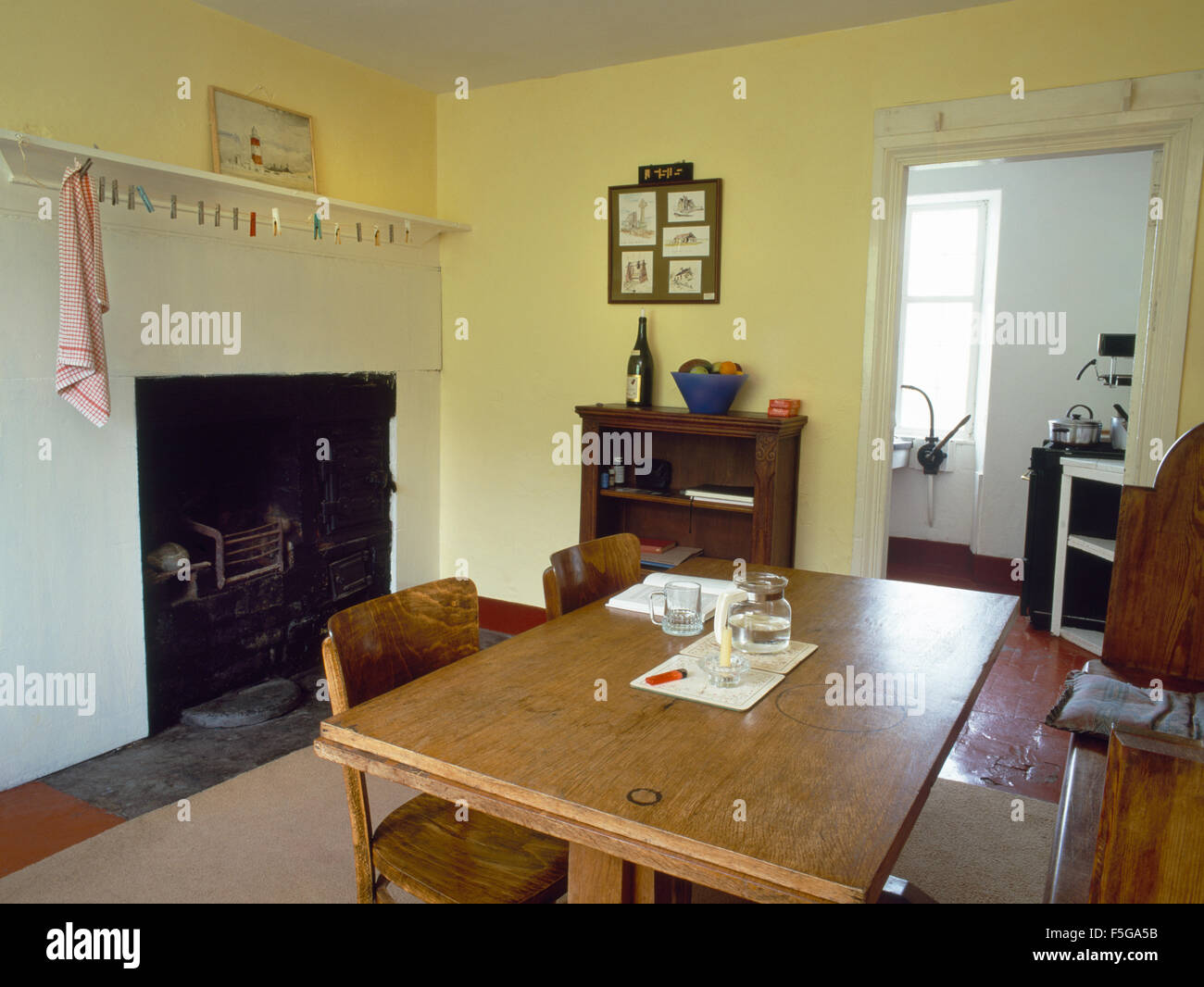 The Dining Room And Old Kitchen Fireplace With Victorian Range Carreg Fawr Bardsey Island North Wales UK Now Used As Holiday Cottage