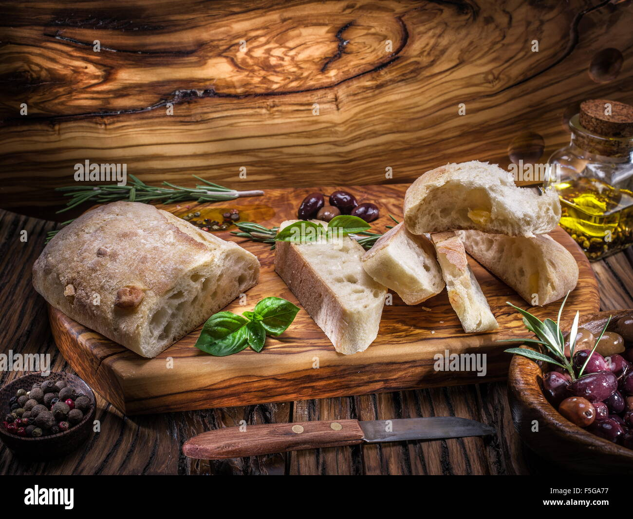 Ciabatta, olives and blue cheese on the wood. Stock Photo