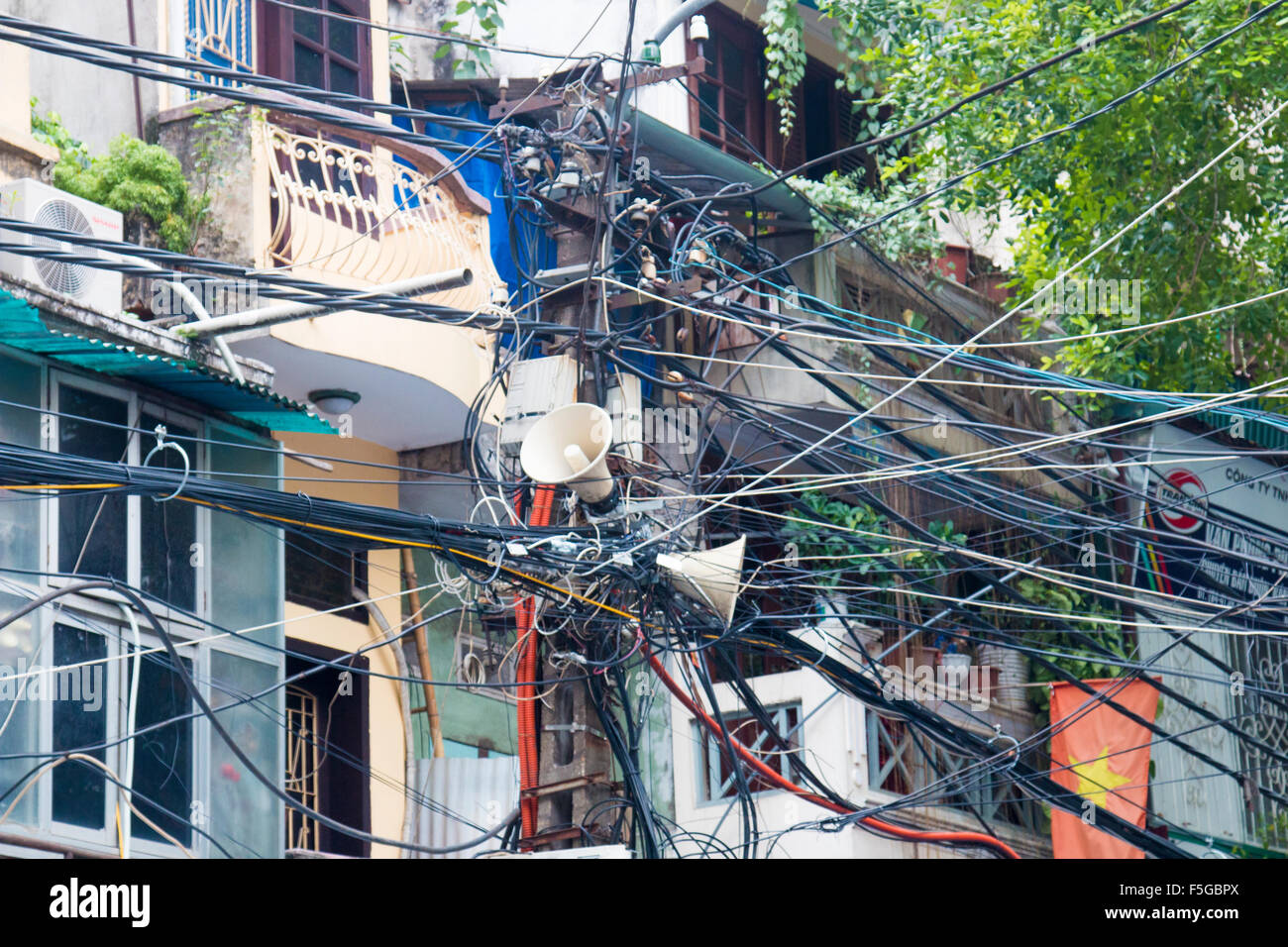 mass of overhead cables and wires in Hanoi old quarter,Vietnam,asia - Stock Image