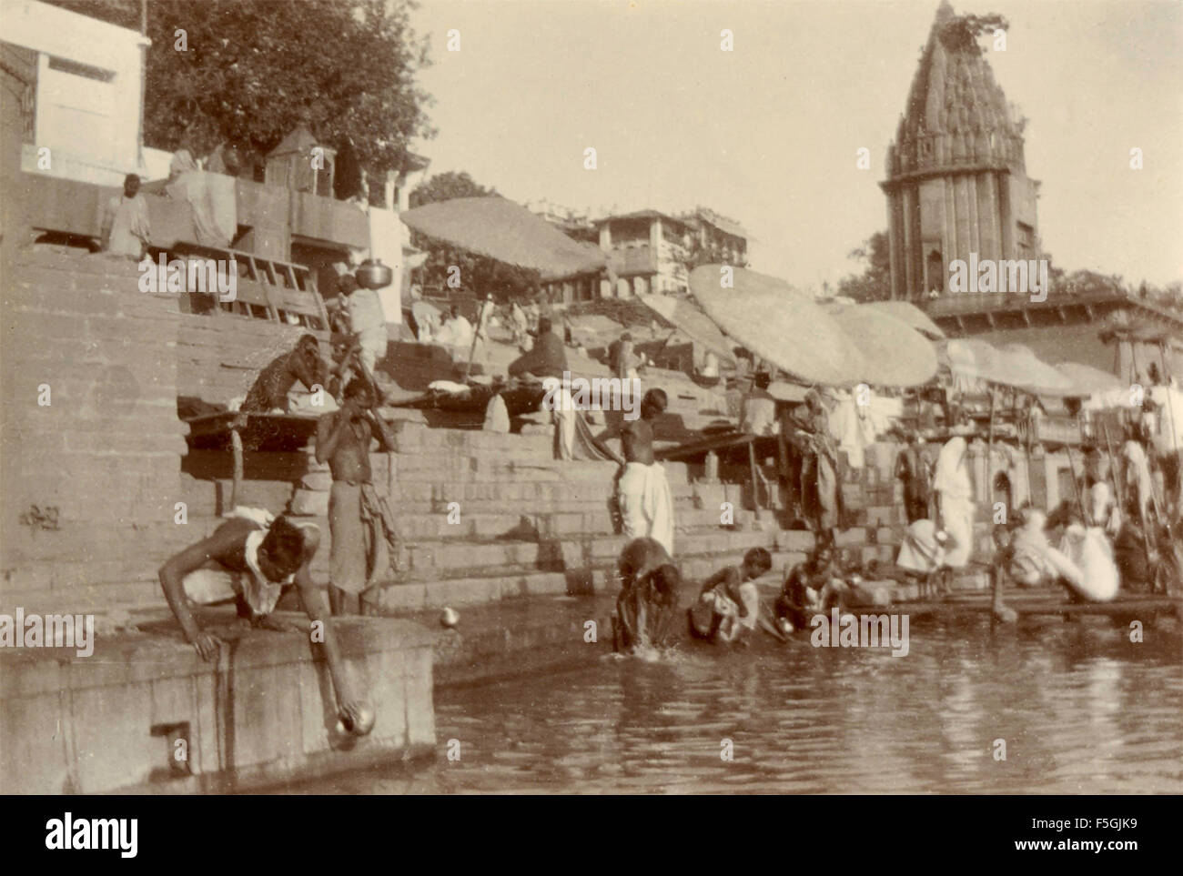 Religious ceremonies along the sacred river in Benares , India - Stock Image