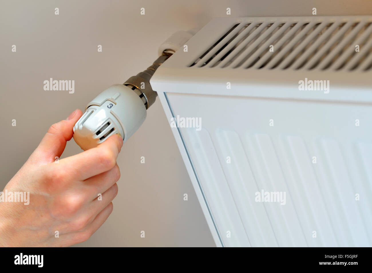 Individual Room Temperature Control Stock Photos Controller Womans Hand Adjusting Thermostat In Winter Time Image