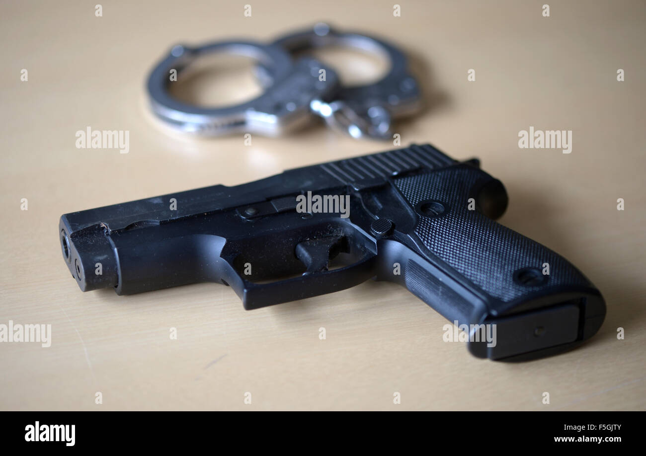 Berlin, Germany, service revolver and handcuffs at the Criminal Investigation Department - Stock Image