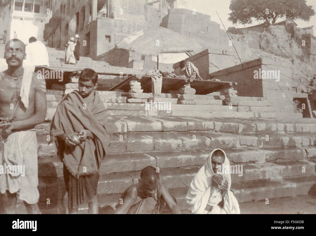 Religious ceremonies along the sacred river in Benares , India Stock Photo