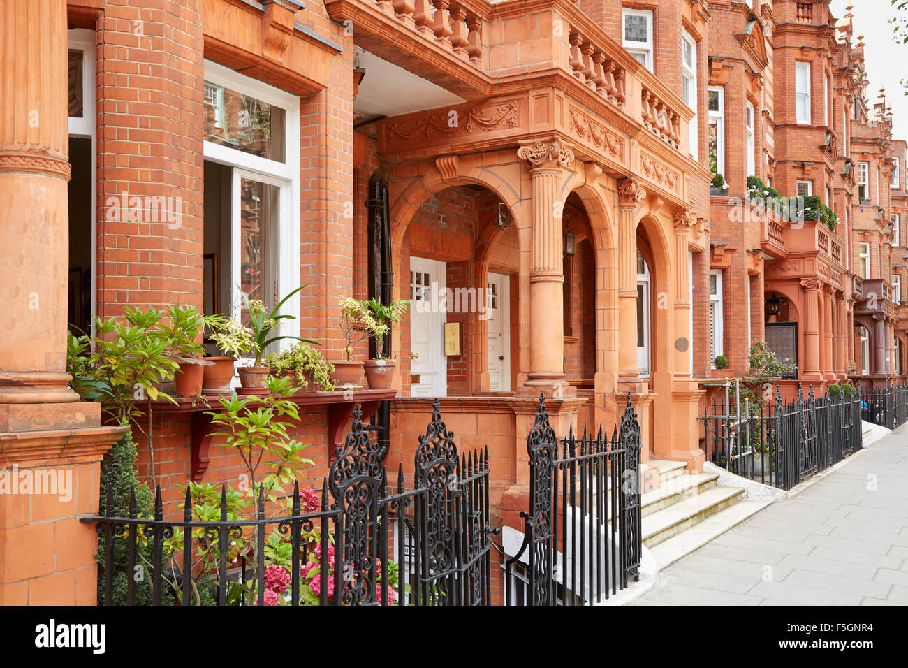Row of red bricks houses in London - Stock Image