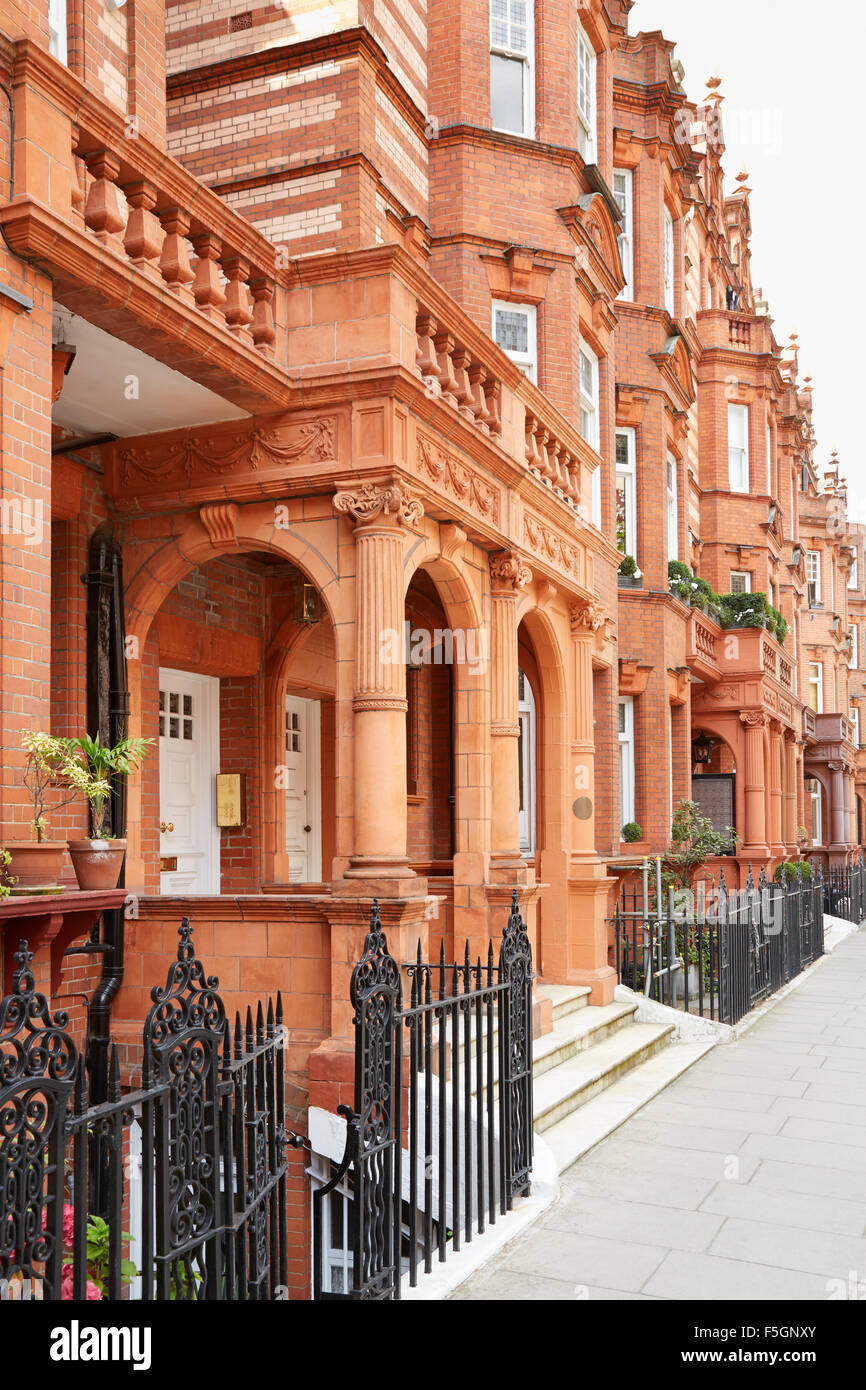 Red bricks houses in London, English architecture - Stock Image