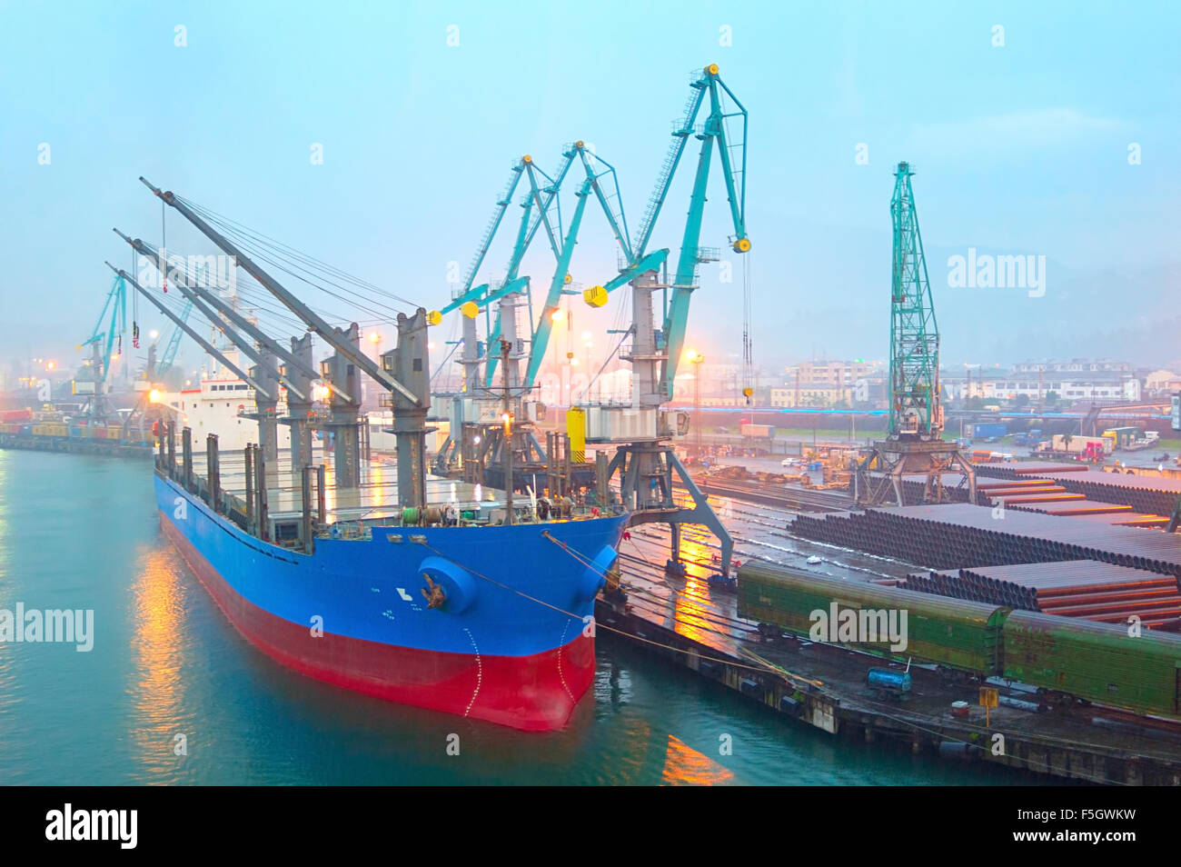 Industrial ship in Batumi port in the rainy evening. Georgia - Stock Image