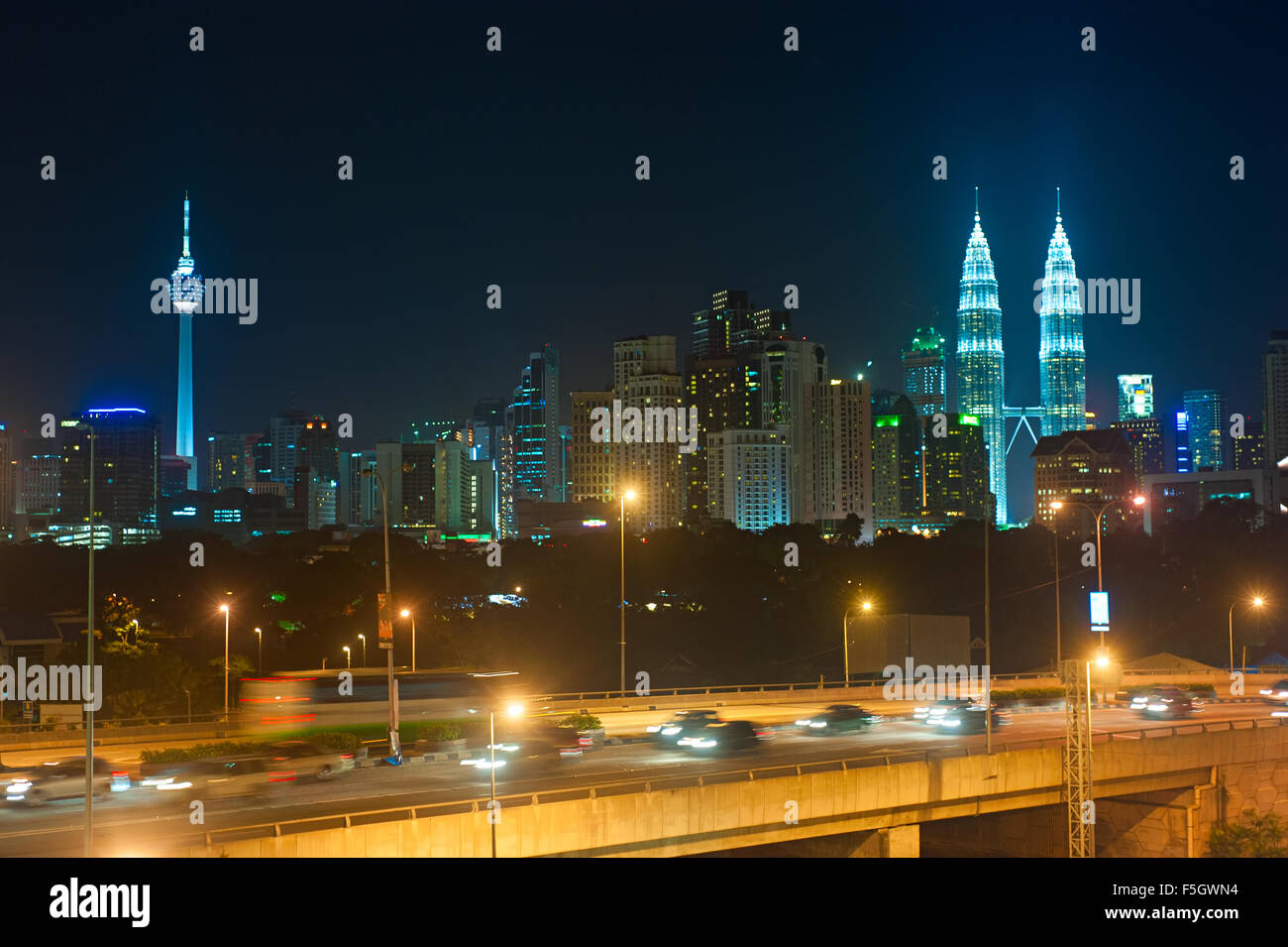 NIght traffic in Kuala Lumpur. Skyline of KL on the background. Malaysia - Stock Image