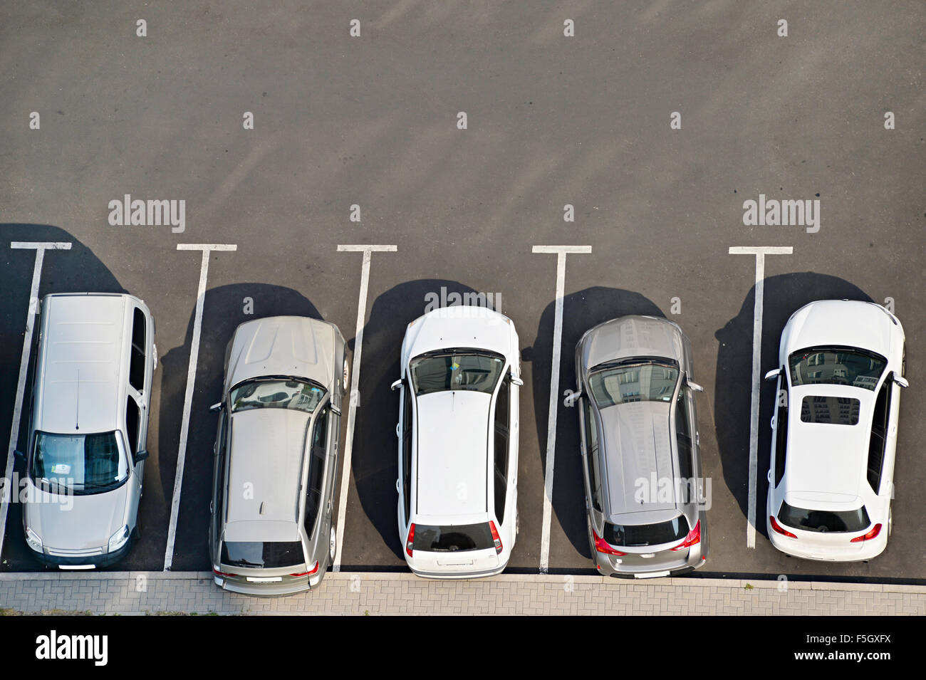 View from above of car parking full of vehicles. Stock Photo