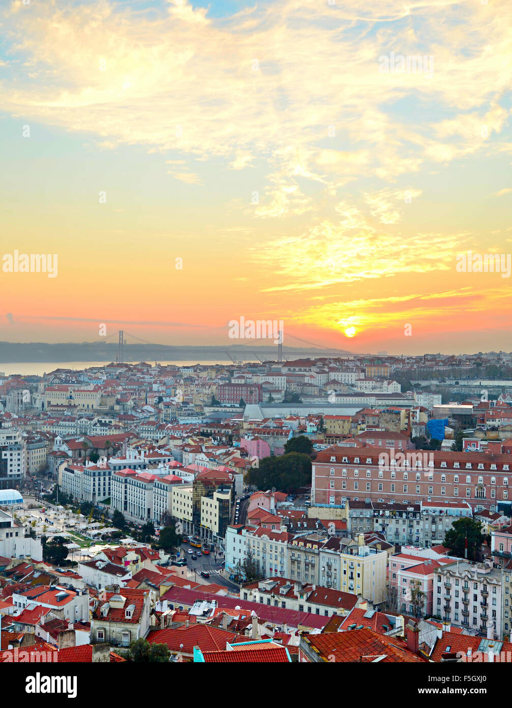 View of Lisbon city center and 25 April Bridge at sunset, Portugal - Stock Image