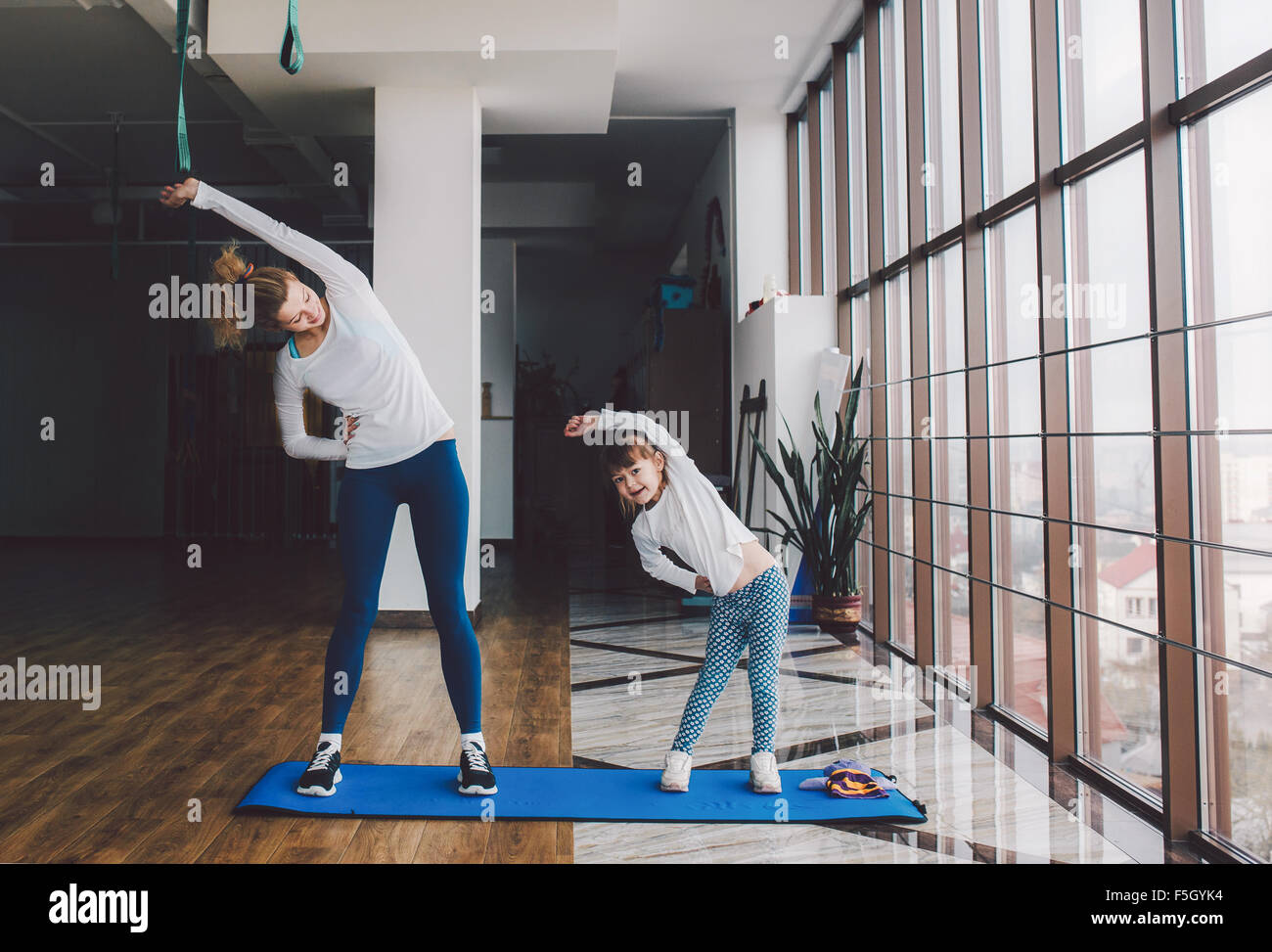 Two girls of different ages makeing yoga - Stock Image