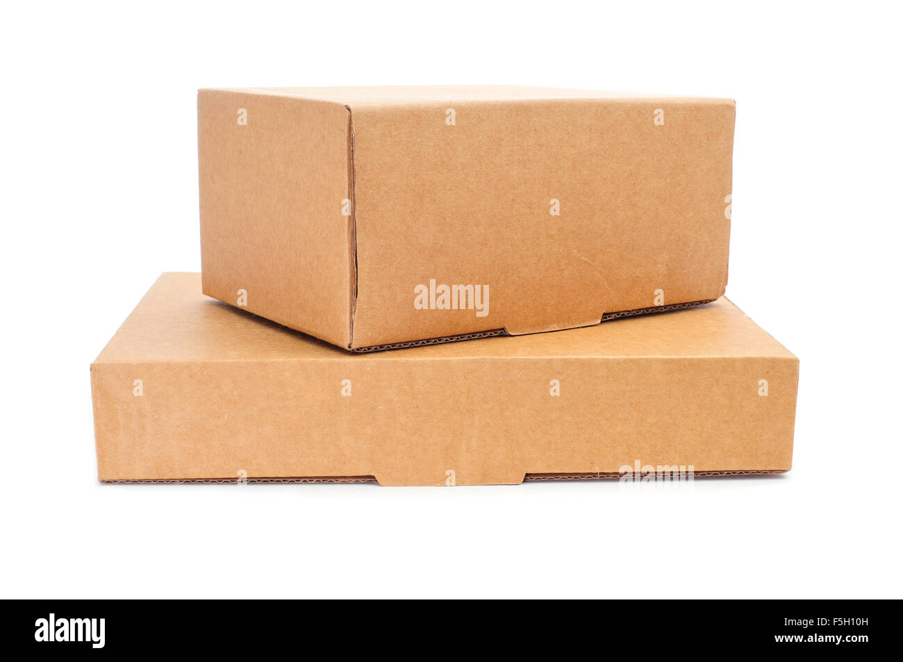 some cardboard boxes of different sizes on a white background - Stock Image