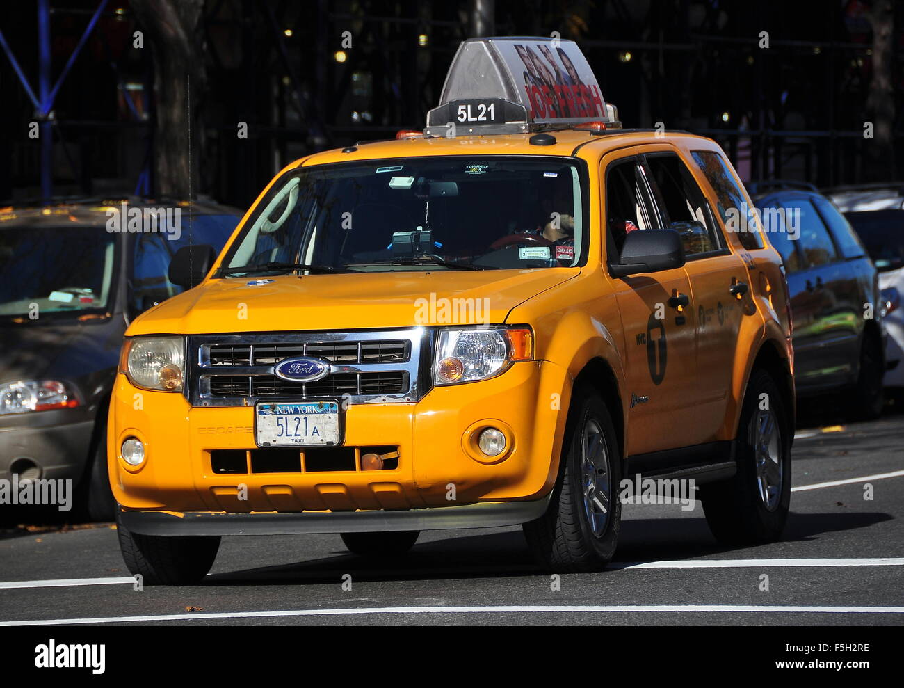 New York City A Ford Suv Medallion Taxi Paused At A Traffic Light