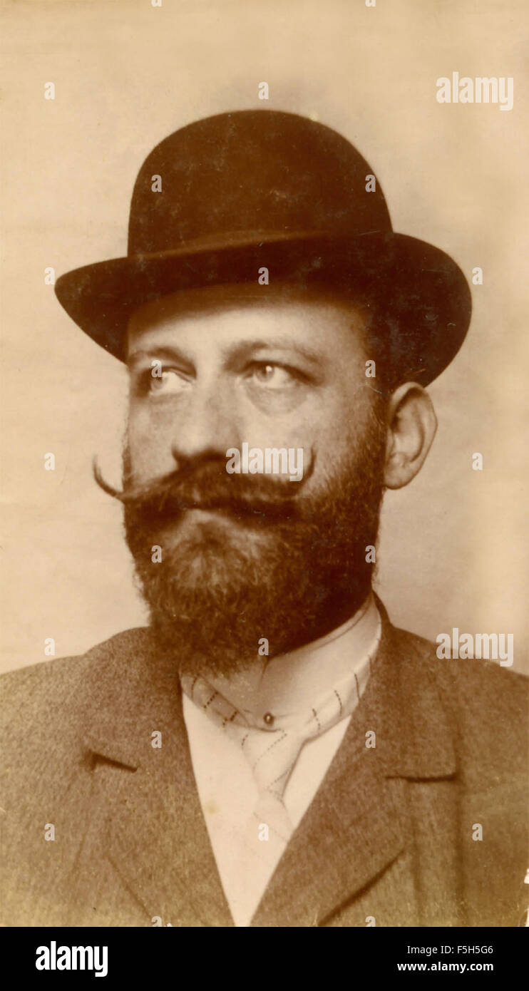 Portrait of a bearded man with hat, Italy - Stock Image