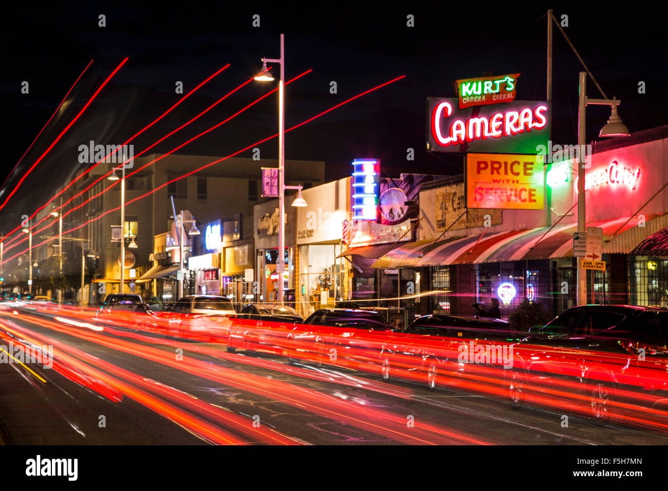 Kurt's Camera Corral neon sign and light streaks on Central Avenue (formerly Route 66), Nob Hill, Albuquerque, - Stock Image