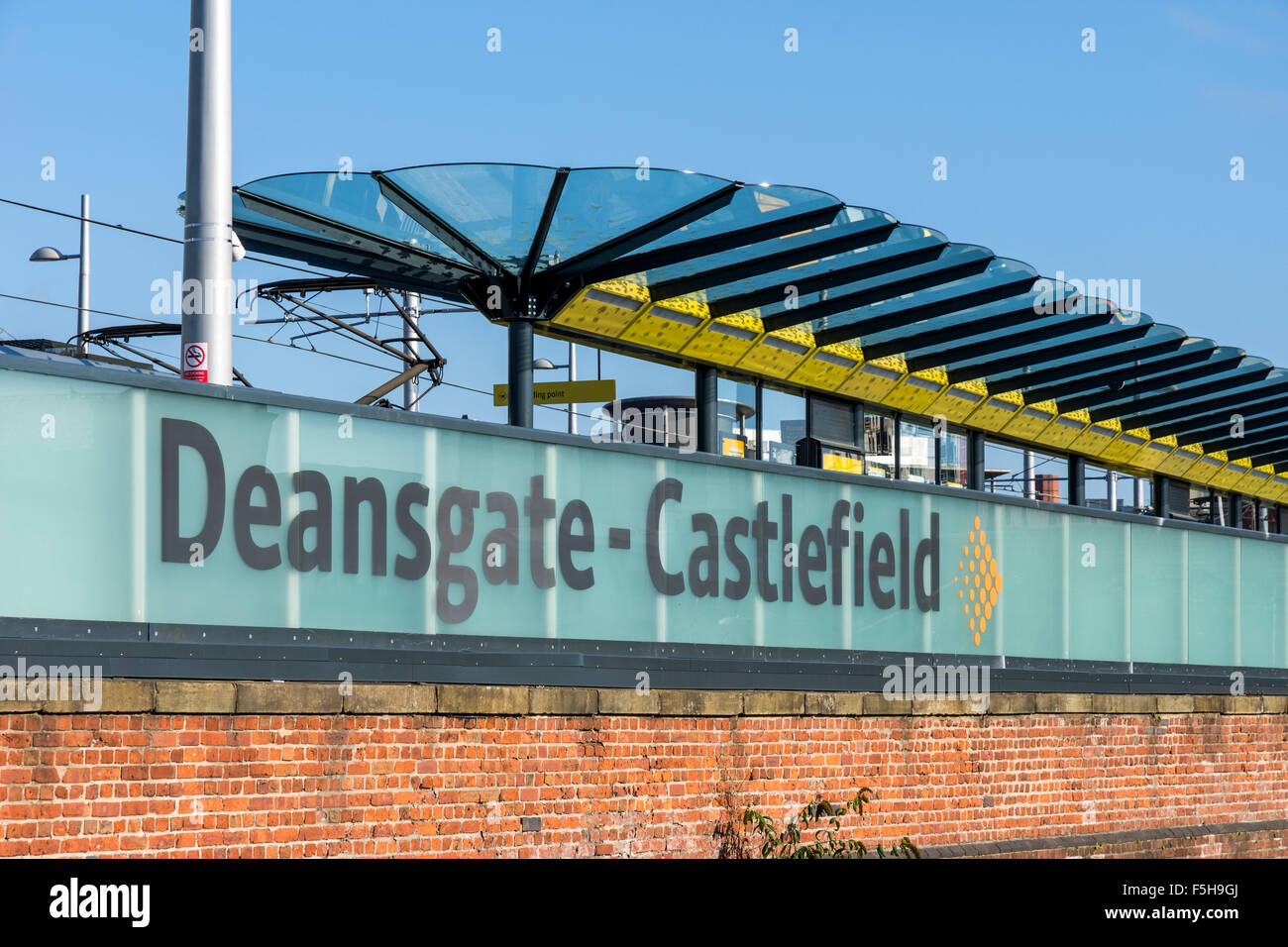 Glass wall and platform canopy at the Deansgate-Castlefield tram stop, Manchester, England, UK - Stock Image