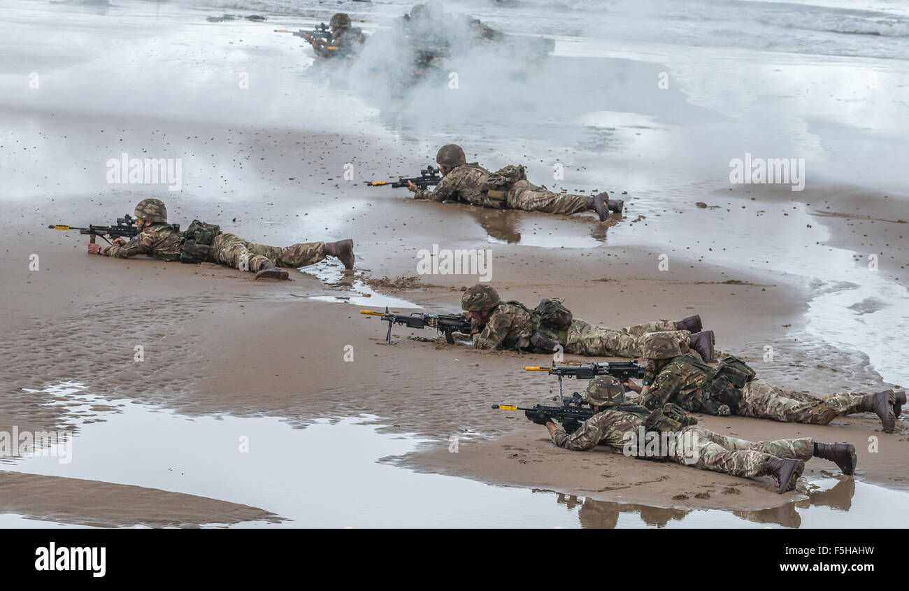 British Royal Marine Commandos perform a beach assault demonstration for the public during the 2015 Sunderland Airshow. - Stock Image