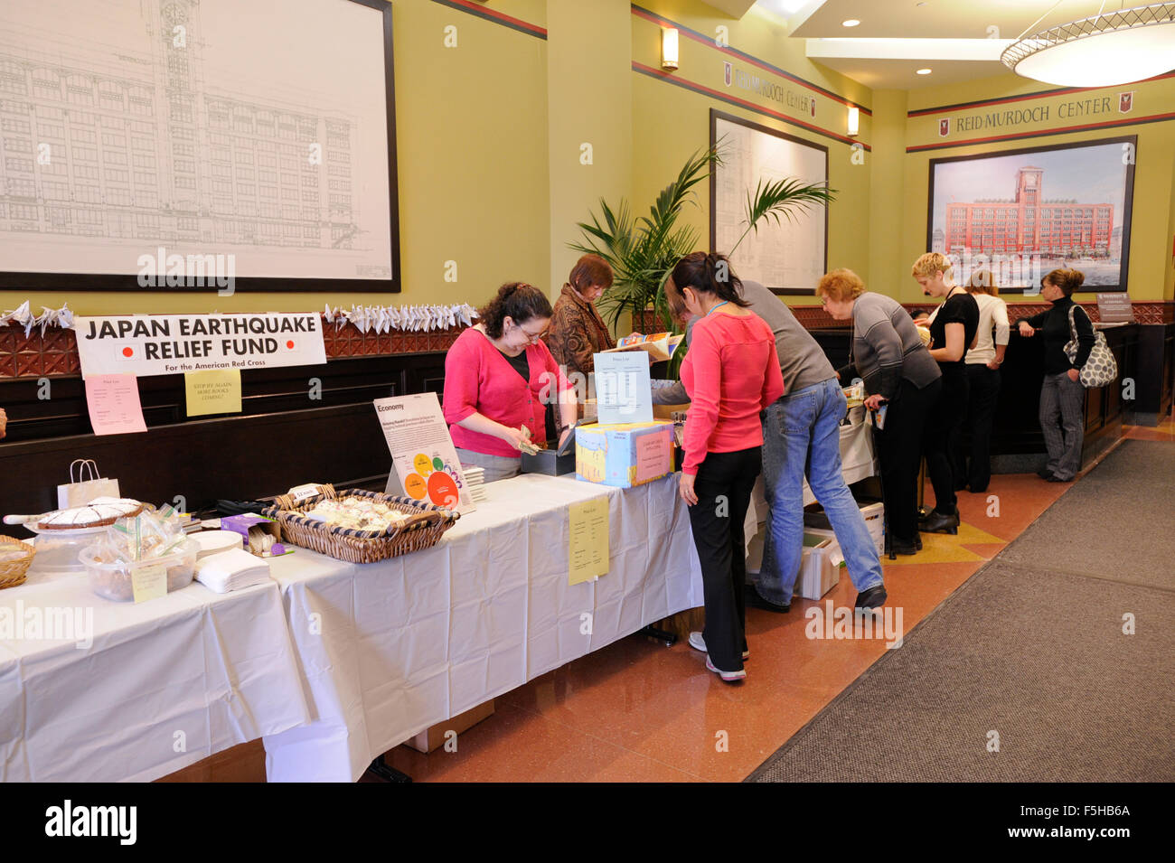 Japan Earthquake and Tsunami Relief Bake and Used Book Sale held by employees of Encyclopaedia Britannica in Chicago, Stock Photo