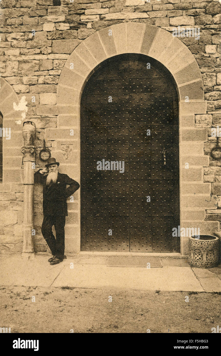 A bearded old man at the door of the Castle of the palace, Italy - Stock Image