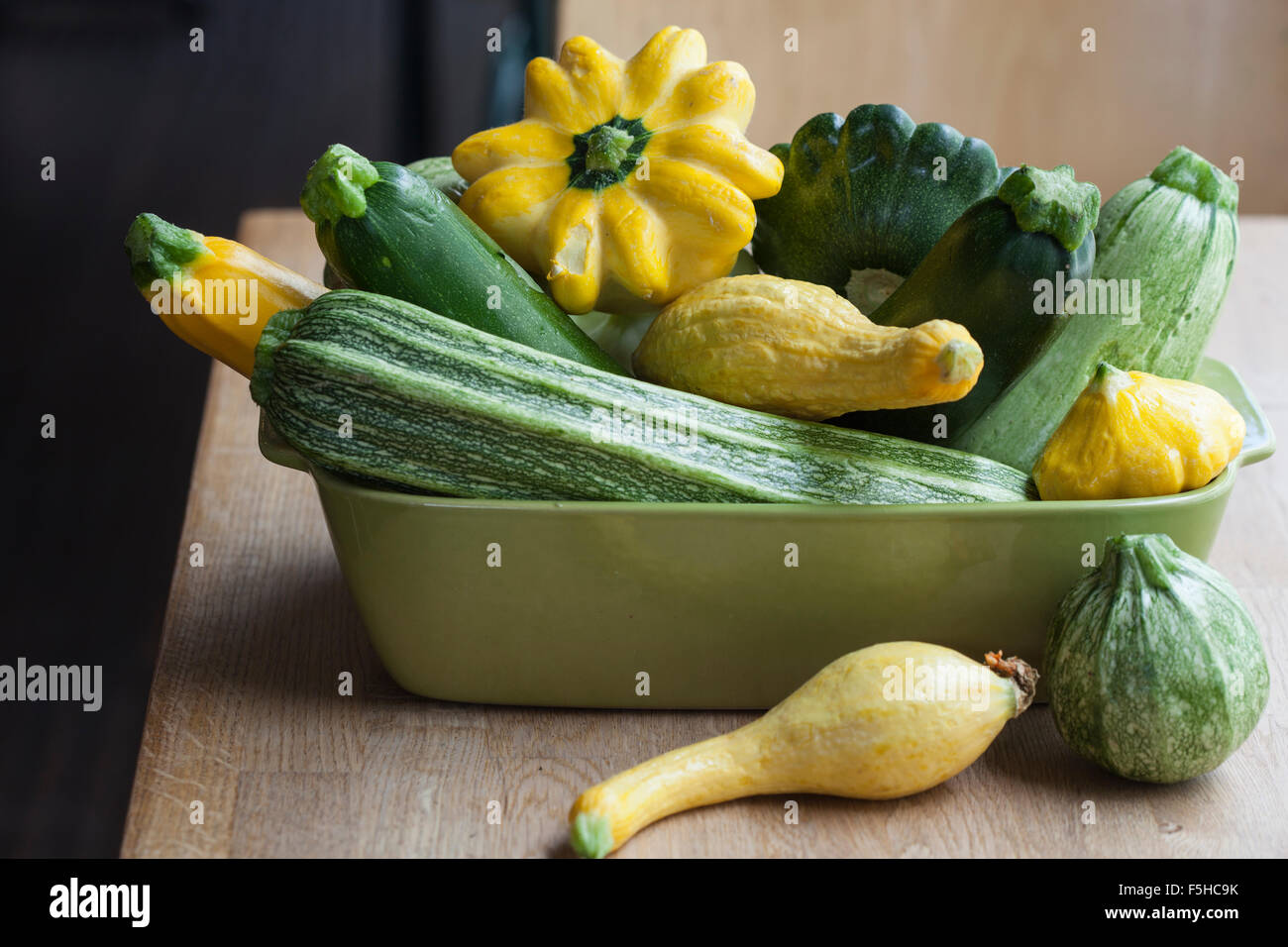 horizontal container has various summer squash - Stock Image