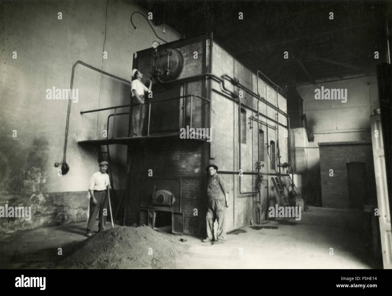 Men at work to a steam boiler, Italy Stock Photo: 89509312 - Alamy