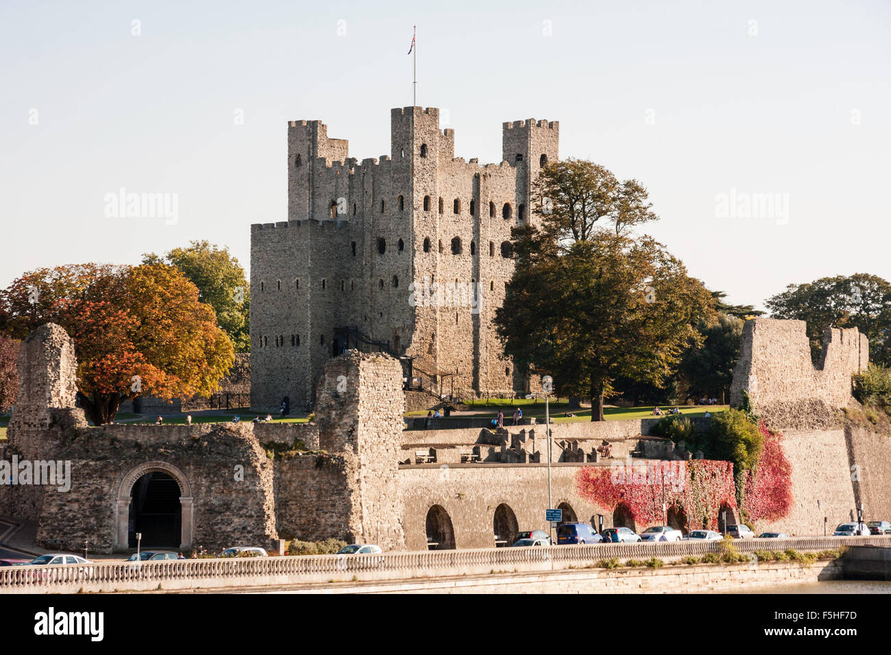 England, Rochester Castle. River view. Main curtain wall with towers and gatehouse, keep on small hill behind. Blue - Stock Image