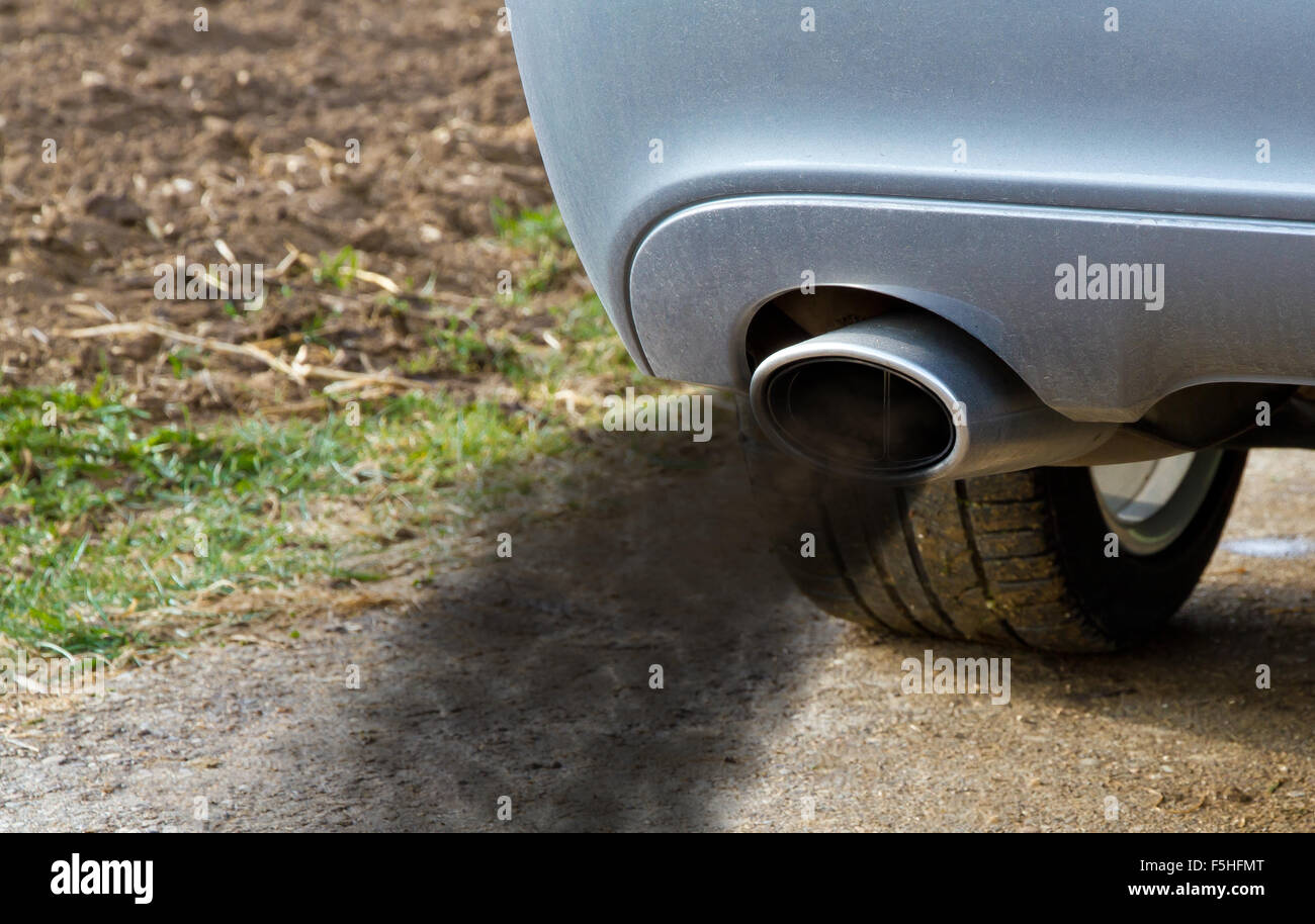 Smoking exhaust pipe of a car - Stock Image