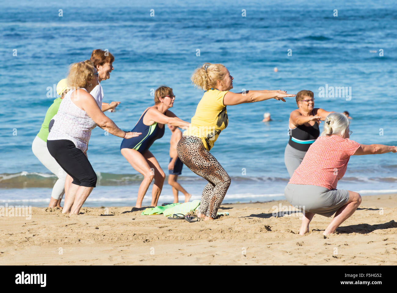 Pensioners daily keep fit class on Las Canteras beach in Las Palmas, Gran Canaria, Canary Islands, Spain - Stock Image