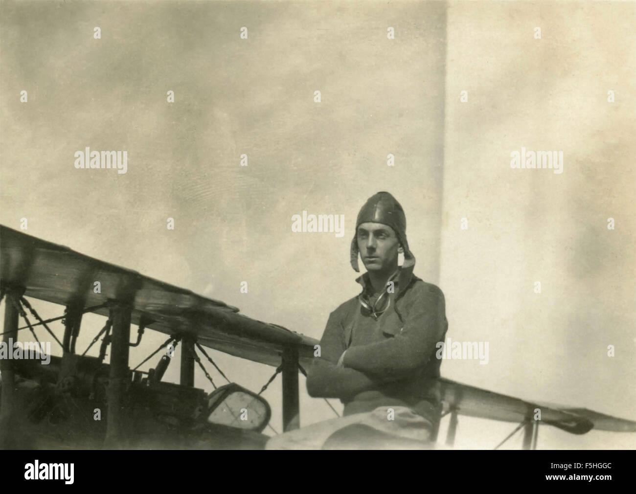 An airman next to his plane, Italy - Stock Image