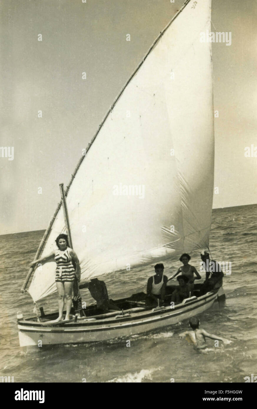 Little family boat with sail Latin, Italian - Stock Image