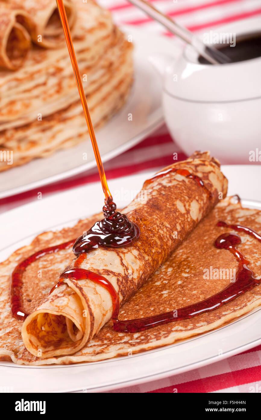 Dutch 'pannenkoeken met stroop' or pancakes with syrup. - Stock Image