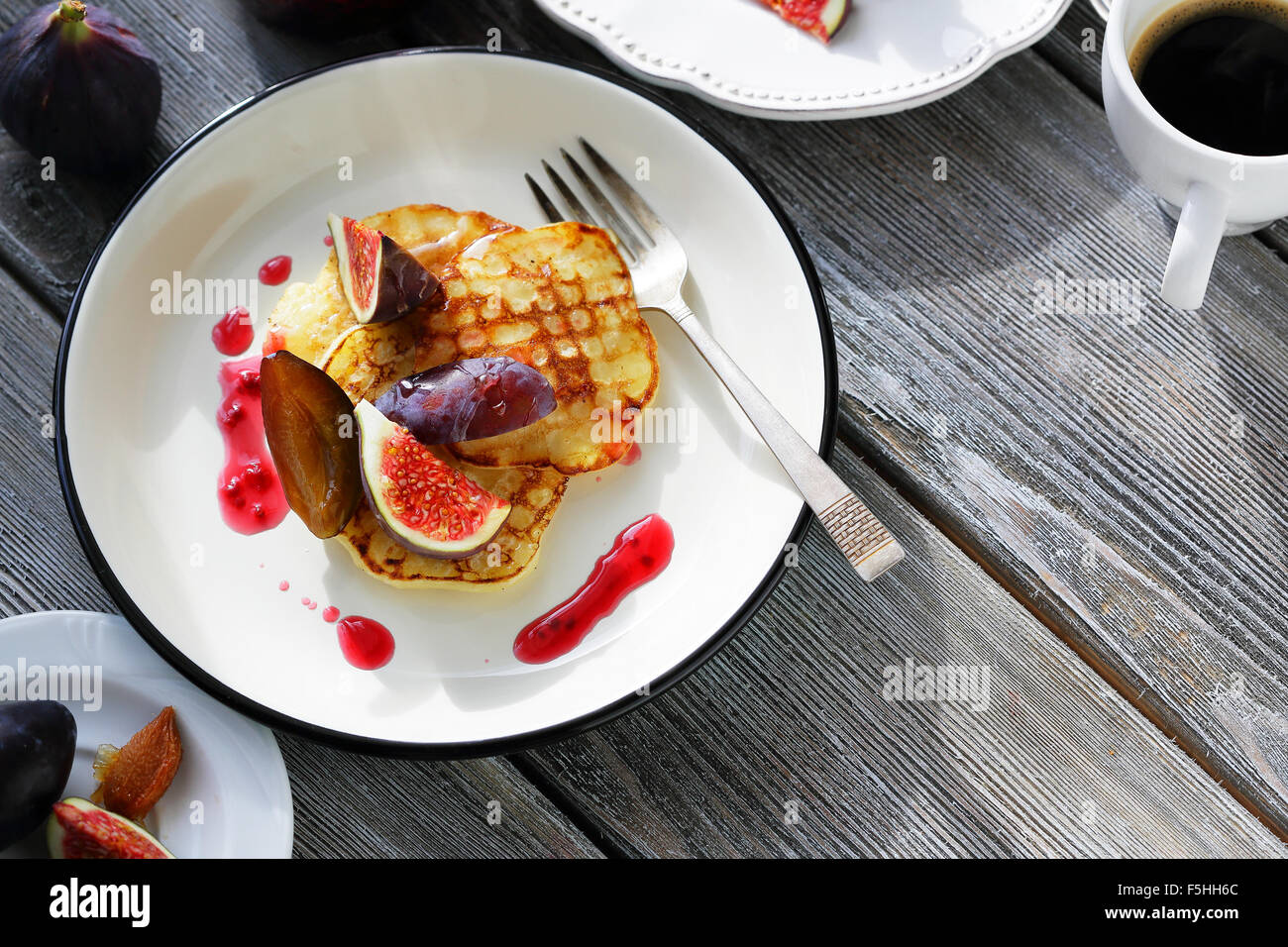 brunch pancakes with figs jam, food close-up - Stock Image