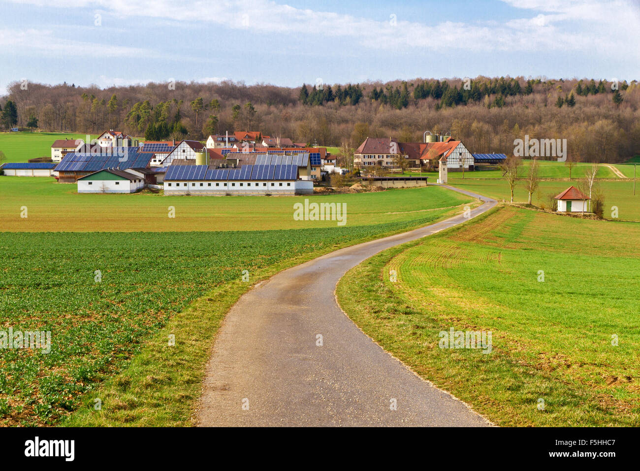 Little village with modern solar cells - Stock Image