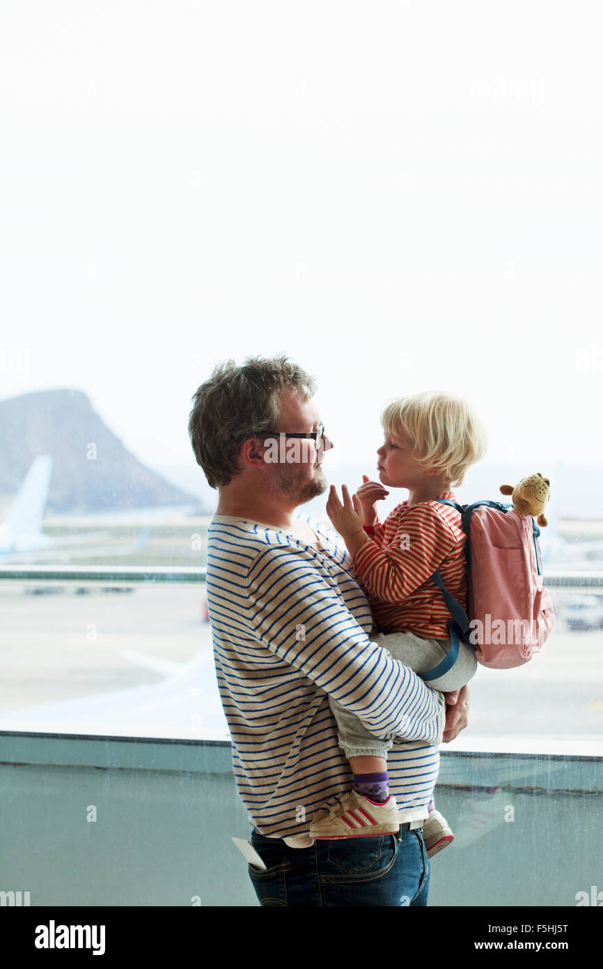 Spain, Tenerife, Tenerife South Airport, Father and daughter (2-3) at airport - Stock Image