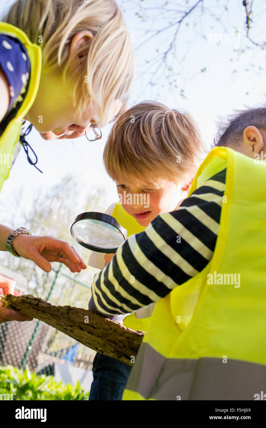 Sweden, Vastergotland, Olofstorp, Bergum, Kindergarten children learning outdoors - Stock Image