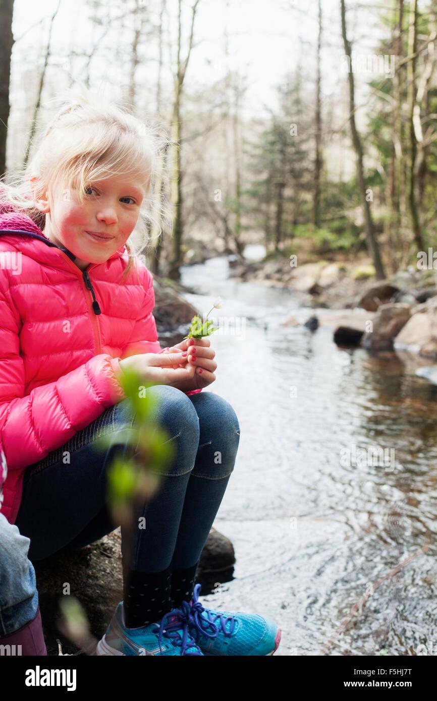 Sweden, Vastergotland, Vattlefjall nature reserve, Portrait of girl (10-11) by river Stock Photo