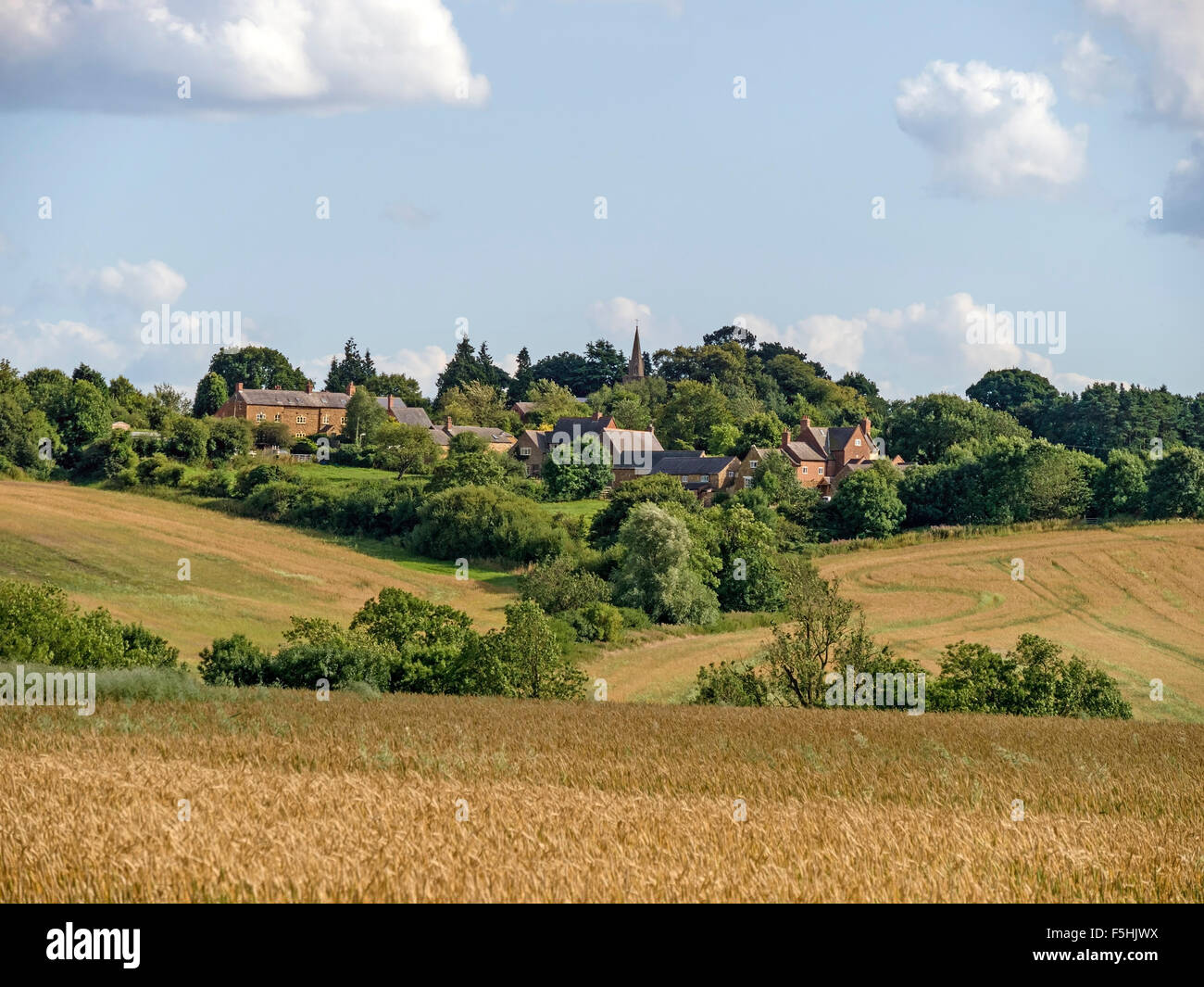The Leicestershire hilltop village of Burrough-on-the-Hill, seen across fields. - Stock Image