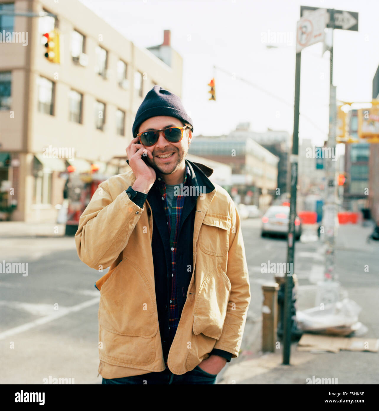 USA, New York State, New York City, Brooklyn, Portrait of man using mobile phone - Stock Image