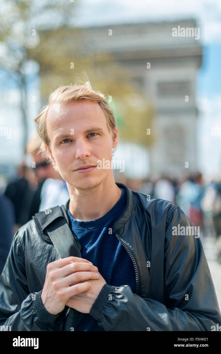France, Paris, Champs-Elysees, Portrait of mid-adult man - Stock Image