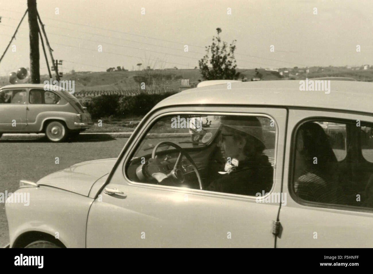 At the wheel of a Fiat 600 , Italy - Stock Image