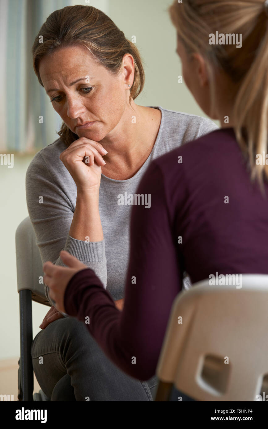 Mature Woman Discussing Problems With Counselor - Stock Image