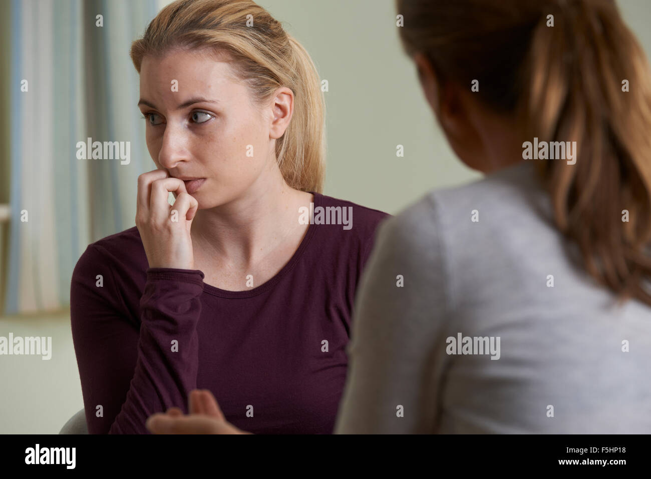 Young Woman Discussing Problems With Counselor - Stock Image