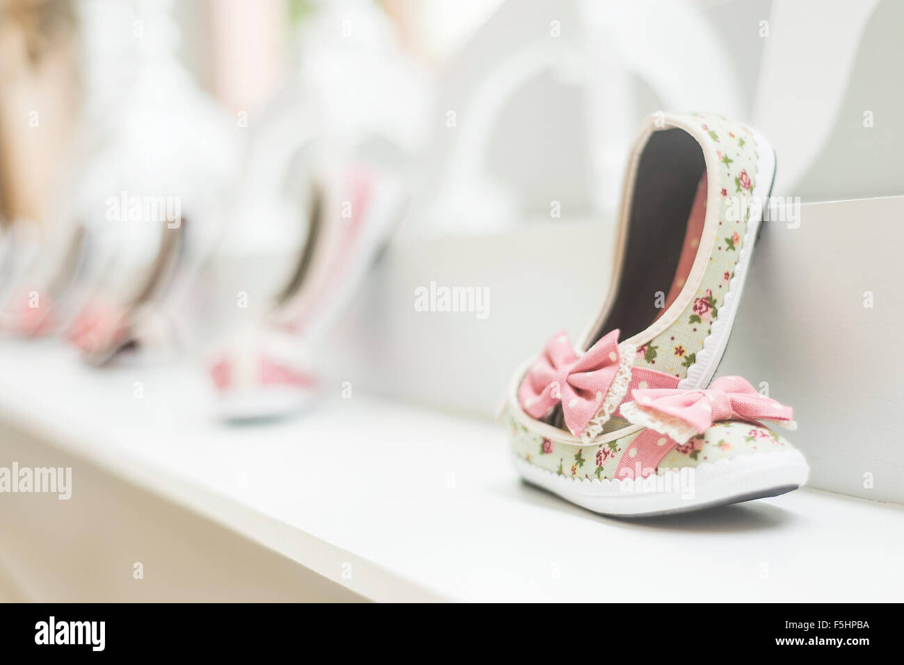 young girl's shoes in children's footwear fashion shop display - Stock Image