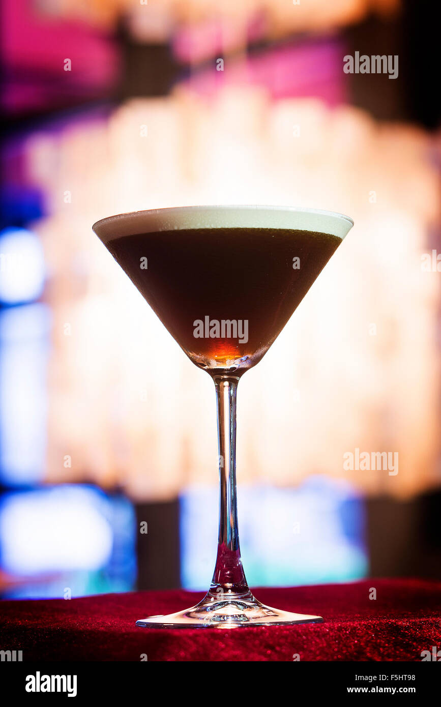 espresso coffee Martini cocktail drink in trendy bar interior - Stock Image
