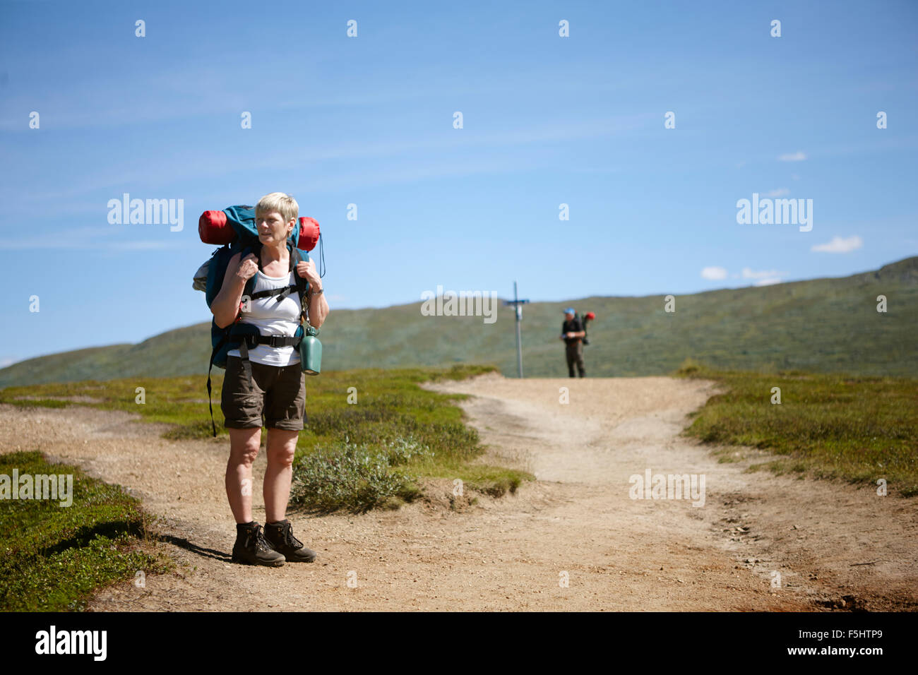 Sweden, Jamtland, Two hikers on footpath - Stock Image