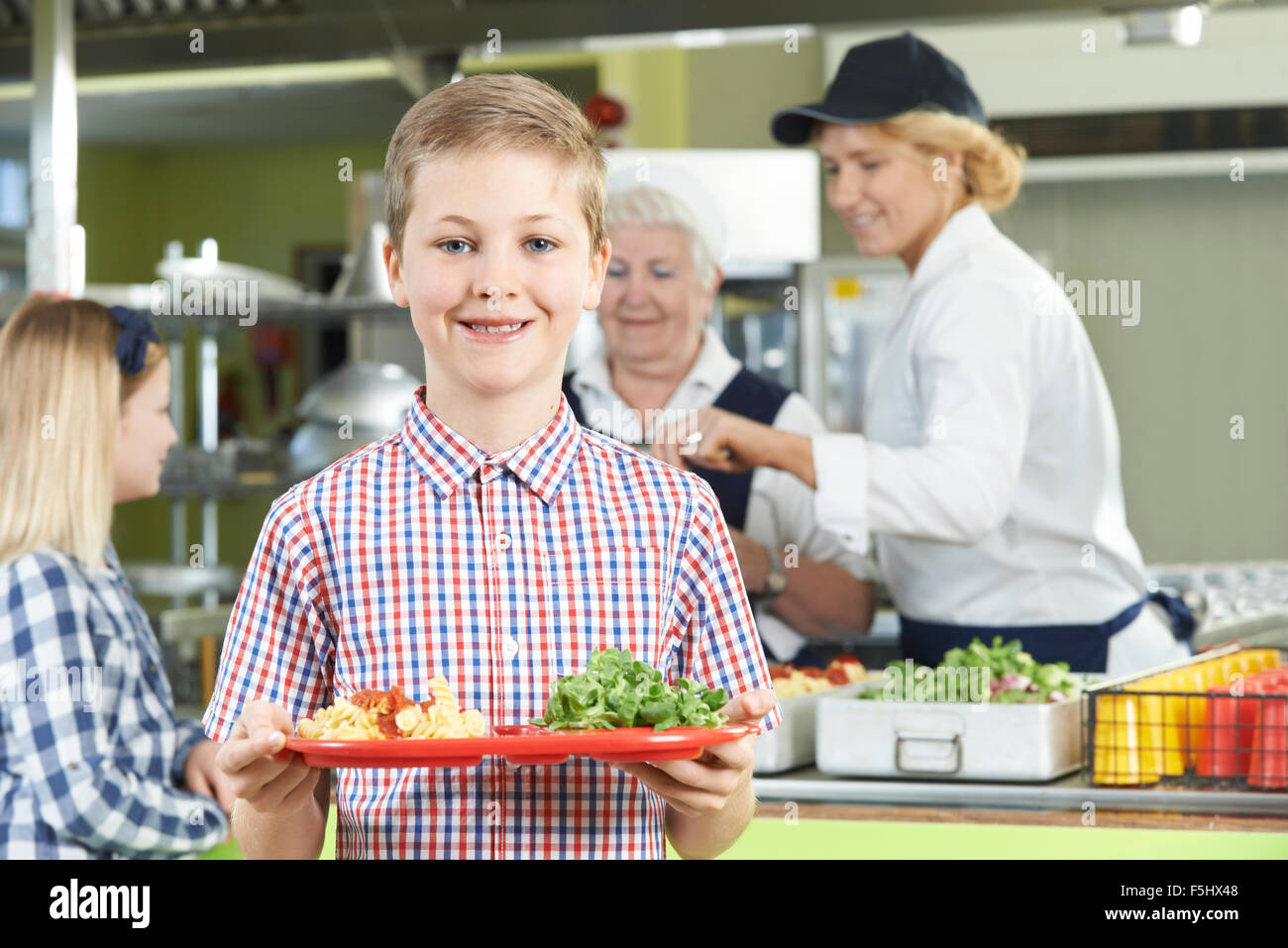 Male Pupil With Healthy Lunch In School Canteen - Stock Image