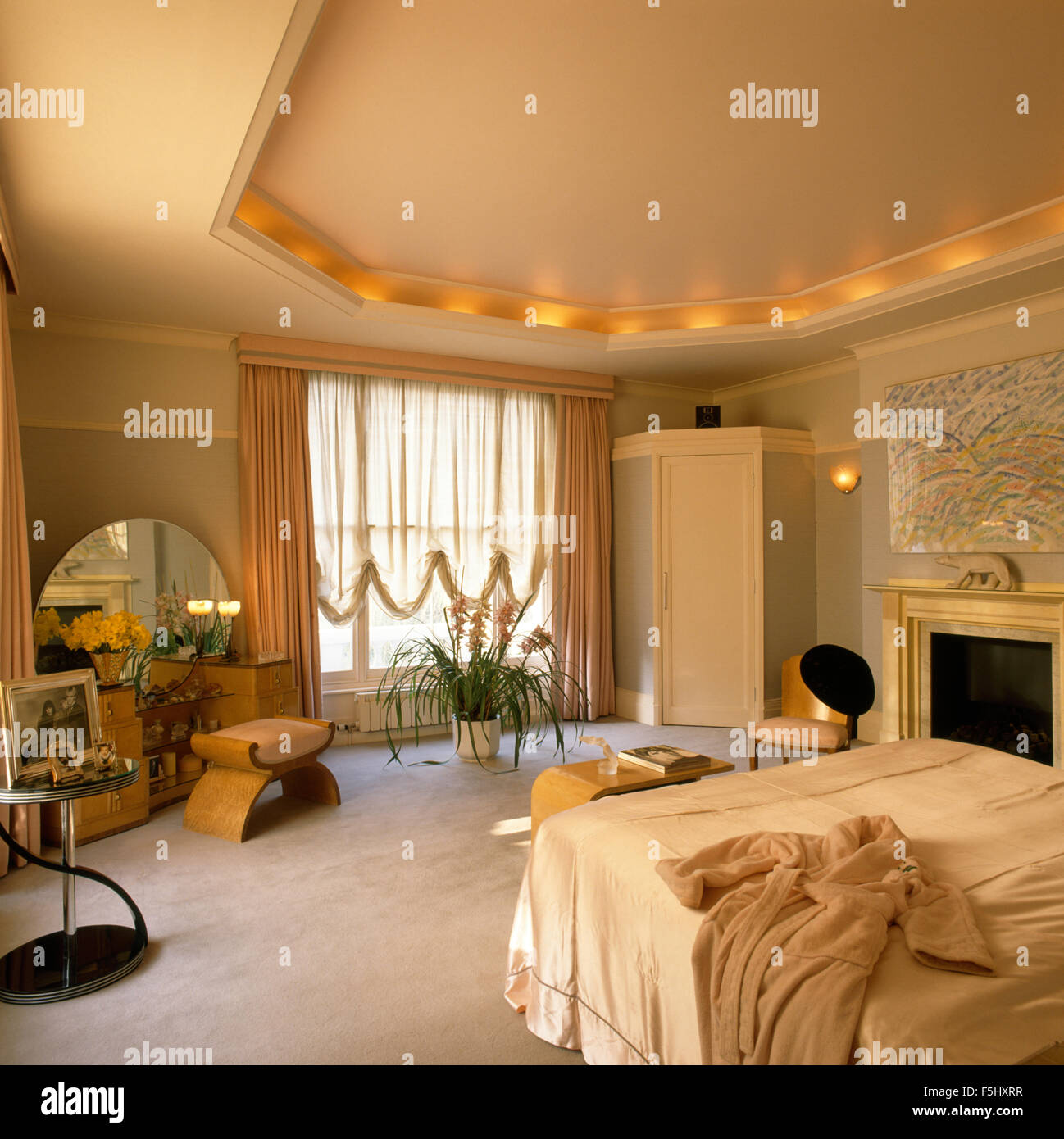 Recessed ceiling with lighting in thirties bedroom - Stock Image